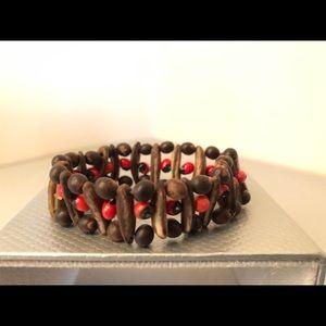 Peruvian wood and Huayruro seed bracelet